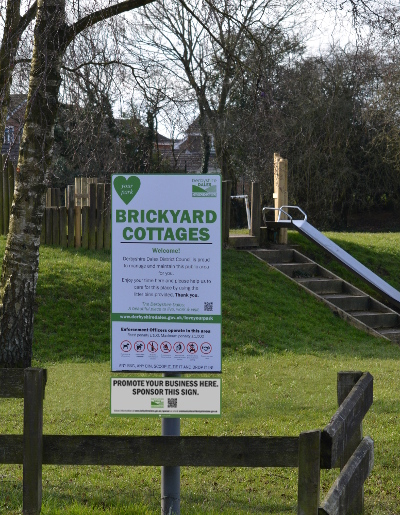 Brickyard Cottages play area sign at Ashbourne