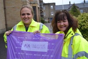District Council parks and street scene assistant Helen Spencer (left) and community engagement officer Ros Hession with one of the Clean for the Queen plastic bags