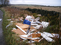 A spate of fly tipping in a field