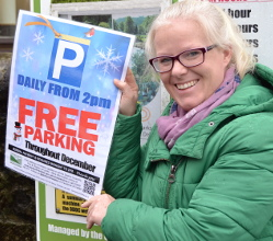 Parks & Streetscene Officer Helen Carrington promoting festive free parking