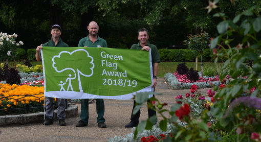 With the flag: District Council Clean & Green Team members Paul Marsden (left) and Scott Palmer (centre) with Clean & Green Central Area Supervisor Ian Buxton.