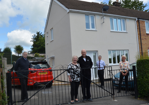 Mr and Mrs Bailey at their revamped home at Hurst Farm with district councillors Steve Flitter (left), Susan Hobson and Director of Housing Rob Cogings