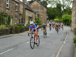 Stage winner Lizzie Armitstead speeds through Darley Bridge