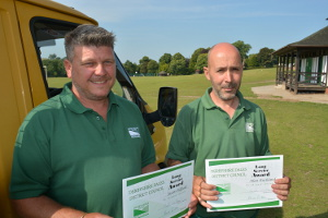 Jason Oldfield (left) and Alan Buckland with their long service certificates