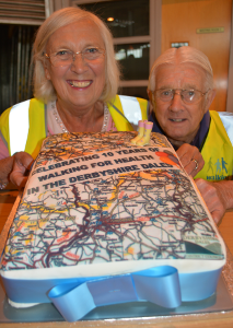 Two of the original walk leaders, Cllr Carol Walker and Trevor Roper, admiring the celebration cake
