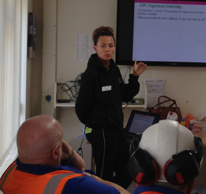 District Council fitness instructor Katy Morten addresses Longcliffe Quarries employees