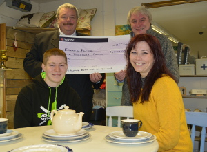 Encore Re-Use project manager John Howells (second right) receives the £1,000 cheque from Cllr Steve Bull, with Encore staff members Josh Roberts and Anneliese Bates