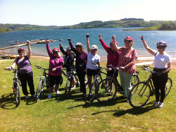 8 females with their bikes at Carsington Water