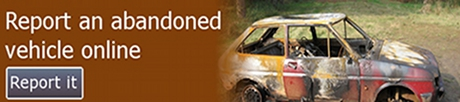 Image of an abandoned vehicle with the text report an abandoned vehicle online
